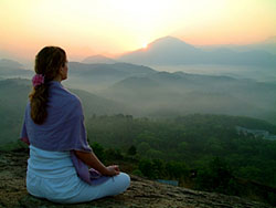 womenmeditatingsunset